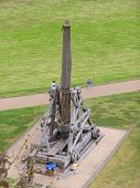 image of trebuchet  - view of an old trebuchet used in the past for throwing stones against the enemies - JPG