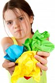Grumpy Girl Holding Crumpled Paper Balls