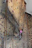 Girl Cimbing Rock Wall