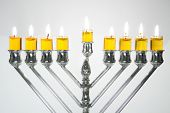 stock photo of dreidel  - Silver Hanukkah candles with oil candles all candles lite on the traditional Hanukkah menorah - JPG