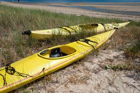 stock photo of cape-cod  - Yellow canoe on the wetland beach Cape Cod - JPG