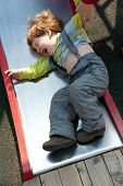 foto of stubborn  - Stubborn naughty boy crying on the playground - JPG