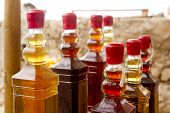 colorful traditional liquor bottles in rows arrangement