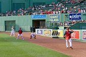 Boston - May 30: Starting Pitcher Jon Lester And Catcher Jarrod Saltalamacchia Warm Up Before Memori