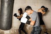 Group Of People In A Boxing Gym poster