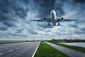 Airplane And Road In Overcast Day poster