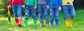 Kids In Rain Boots. Rubber Boots For Children. poster