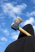 stock photo of infraction law  - man with an axe on sky background - JPG