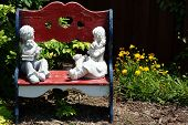 Wooden bench in a flower garden