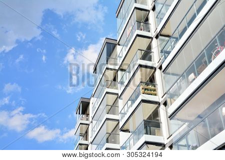 poster of Modern Apartment Buildings On A Sunny Day With A Blue Sky. Facade Of A Modern Apartment Building