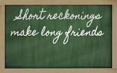 Expression -  Short Reckonings Make Long Friends - Written On A School Blackboard With Chalk