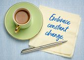 Embrace constant change - handwriting on a napkin with a cup of coffe poster