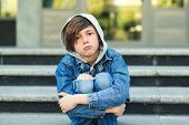 Sad Boy Is Sitting On The Stairs, Before School. Alone Unhappy Child In City Street. Bullying, Depre poster