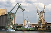 Large mobile crane floating in Antwerp harbor and loading a ship, this crane is able to lift 800 ton