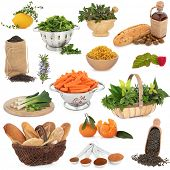 Large healthy food collection high in antioxidants and vitamins over white background.