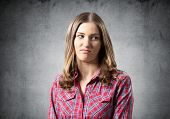 Distrustful Brown Haired Woman Looks Suspiciously. Skeptical Girl Has Dissatisfied Facial Expression poster