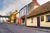 BUNRATTY, IRELAND - FEB 19: 19th century village street of Bunratty Folk Park, traditional Irish tourist attraction of Co. Clare - Feb 19, 2012 in Bunratty Folk Park, Co. Clare, Ireland.