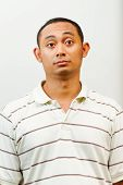 Asian Young Man With Questioning Face Expression