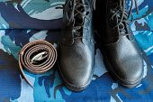 Army Boots And Army Belt On Blue Camouflage Fabric. Overalls For The Soldier. poster