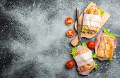 Fresh Ciabatta Sandwiches With Ham, Cheese, Lettuce, Tomatoes, Stone Concrete Background, Close-up,  poster