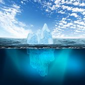 Antarctic iceberg in the ocean. Beautiful polar sea background.