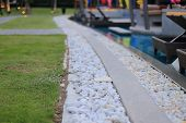 Swimming Pool Drainage System Grating Covered With Round White River Stone Pebble. Swimming Pool Arc poster