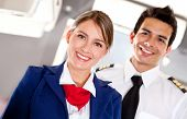 stock photo of cabin crew  - Airplane cabin crew with pilot and flight attendant smiling - JPG