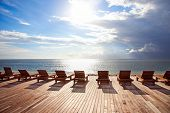 Chaise longue in sunset,on Trawangan beach,Gili island, Indonesia