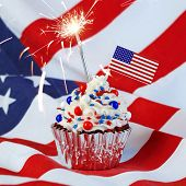 4th of July cupcake with flag, sprinkles, and sparkler poster