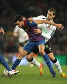 BARCELONA - FEB 19: Sergio Busquets(L) of FC Barcelona vies with Roberto Soldado(R) of Valencia CF d