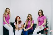Four Hairdressers Posing In The Barber Shop. Four Employees Of The Beauty Salon Smiling And Looking  poster
