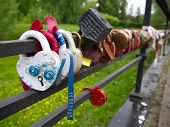 Multi-colored Padlocks With Keys Thrown Into The River. Symbols Of Fidelity And Love Are Padlocks Wi poster