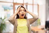 people, stress and despair concept - stressed asian woman holding to her head over office background poster