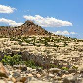 Piled Rocks On Rocky Terrain In Moab Utah poster