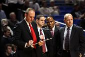 Ohio State coach Thad Motta and staff draw up a play during a game