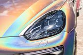 Close-up Led Headlight Expensive Car Part With Exclusive Iridescent Painting. Vehicle Covered With V poster