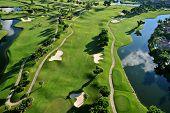 stock photo of golf  - aerial view of manicured golf course in florida - JPG
