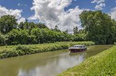 picture of upstream  - Boat traveling upstream the canal Burgundy France - JPG
