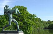 Sculpture Of A Man Bears A Woman