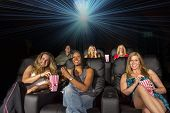 A group of people watching a movie showing emotion