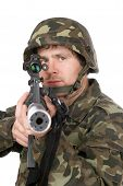 stock photo of m16  - Armed soldier aiming m16 in studio - JPG