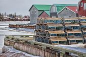 Winter view of lobster traps stacked up on the wharf of French River, Prince Edward Island, Canada.