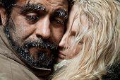 Portrait of couple with sad frozen faces hugging