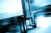 stock photo of trucks  - Semi Truck in Motion - JPG