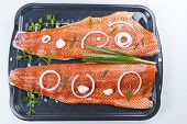 picture of steelhead  - Wild Salmon Fillets in baking pan with herbs and spices on white background - JPG