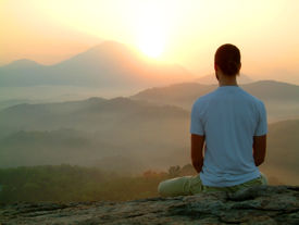 picture of pranayama  - man doing Meditation at Sunrise on hill - JPG