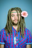 stock photo of hippy  - Portrait of a hippie young man with a flower - JPG