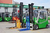 Electric forklift stackers in a row