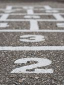 pic of hopscotch  - Hopscotch game with close focus on stone