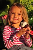 Little Girl Eating Sweet Cupcake